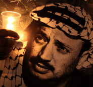 2013_11_9-Palestinians-hold-posters-and-light-candles-as-they-commemorate-the-death-of-late-Palestinian-leader-Yasser-Arafat