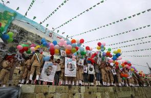 الكشافة تطلق بالونات تحمل صور الشهداء والأسرى في مهرجان انطلاقة حماس