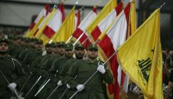 Hezbollah-fighters-holding-up-Lebanese-flags
