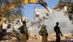 bulldozer_demolishes_two_Palestinian_houses_in_the_village_of_Hares