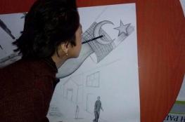 معاقة أفغانية تهدي لوحة لأردوغان رسمتها بفمها