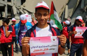 وقفة للأطفال احتجاجاً على سياسة استهداف جيش الاحتلال للأطفال بشكل مباشر