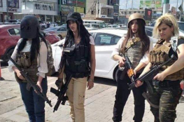 بزي اللعبة وأسلحتها.. هكذا احتجت عراقيات على حظر لعبة بوبجي