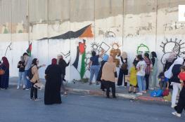 الاحتلال يعتدي على فعالية لرسم صور الشهداء المحتجزة جثامينهم في أبو ديس