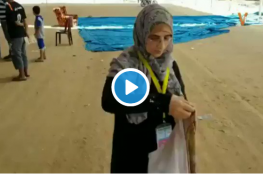 VIDEO : The mother of the martyr Razan Najjar wear her daughter bloodied medical coat