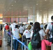 A-group-of-people-at-Ben-Gurion-Airport-in-Israel-wait-in-line
