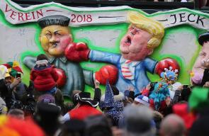 مجسمات للرئيس الأميركي وزعيم كوريا الشمالية خلال الكرنفال التلقيدي بألمانيا