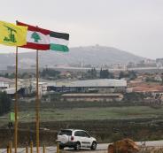 1562701-أعلام-لبنان-وفلسطين-وحزب-الله-فى-المنطقة-الحدودية