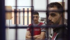 Palestinan-prisoners-wait-for-their-turn-inside-a-cell