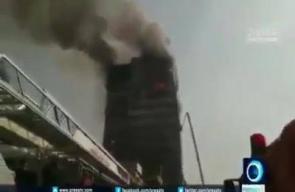 #شاهد لحظة انهيار المبنى ..   مصرع نحو 30 رجل إطفاء جراء انهار مبنى مؤلف من 15 طابقا وسط طهران بعد اشتعال النيران فيه