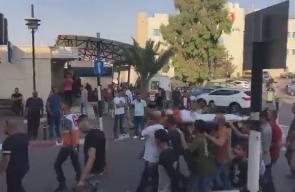 #فيديو نقل الشهيد محمد خلف لافي الى بلدته ابو ديس بالقدس استعدادا لتشييعه