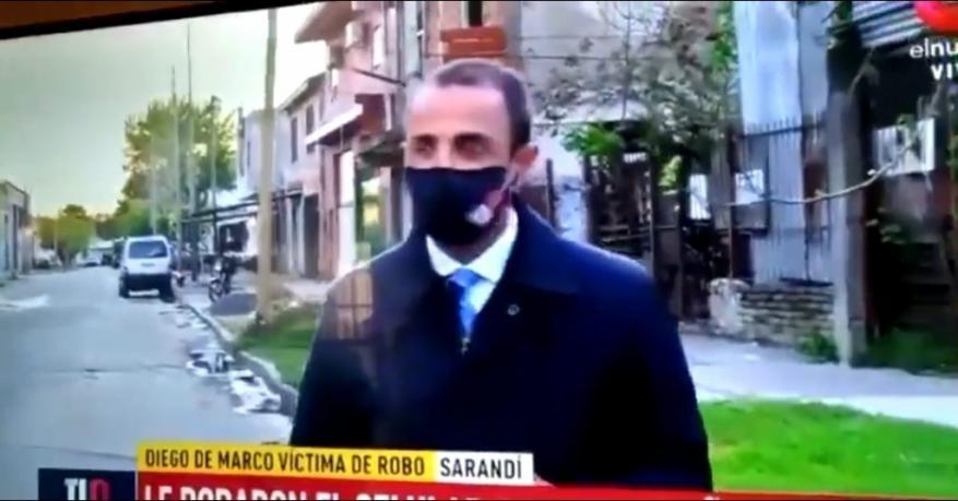 شاهد  لص يسرق هاتف مراسل صحفي على الهواء مباشرة