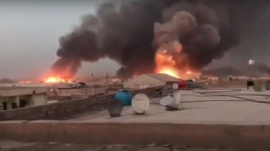العراق.. 13 مصابا نتيجة احتراق مخزن للعتاد جنوبي بغداد