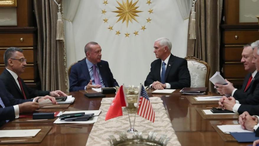"""مسؤول تركي يكشف كواليس مفاوضات تعليق """"نبع السلام"""".. وماكرون ينتقد الاتفاق التركي الأميركي"""